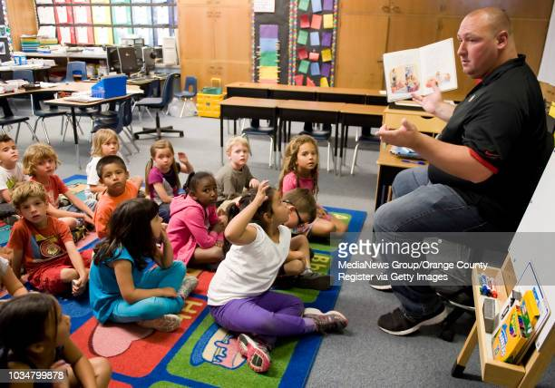 Davis Magnet School kindergarten teacher James Christman right reads to his students Davis Magnet received a statewide API rank of 10 The highest a...