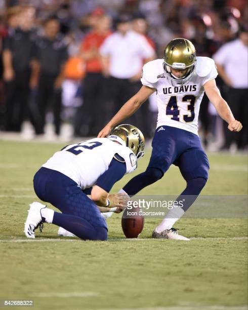 Davis Max O'Rourke kicks an extra point during the college football game between UC Davis Aggies and San Diego State University Aztecs on September...