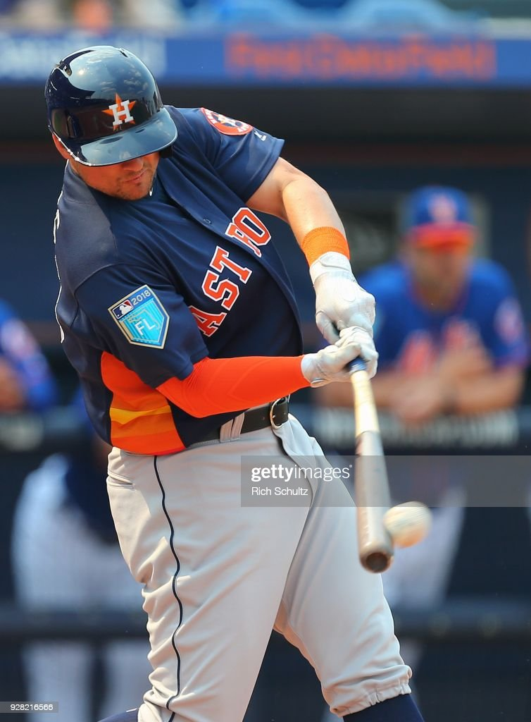 J.D. Davis #28 of the Houston Astros hits a double against the New York Mets during a spring training game at First Data Field on March 6, 2018 in Port St. Lucie, Florida. The Mets defeated the Astros 9-5.