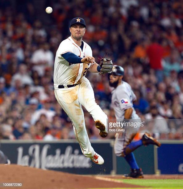 Davis of the Houston Astros throws out Elvis Andrus of the Texas Rangers in the third inning at Minute Maid Park on July 28, 2018 in Houston, Texas.