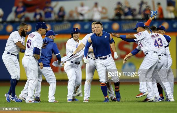 Davis of the New York Mets celebrates his first career walk off single to win the game against the Cleveland Indians in the 10th inning at Citi Field...