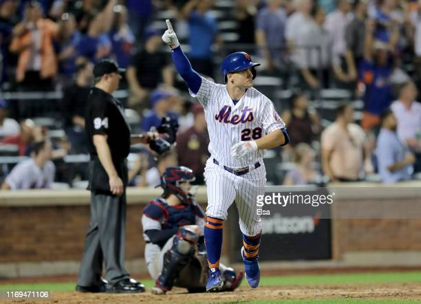 D Davis of the New York Mets celebrates his walk off single in the 10th inning against the Cleveland Indians at Citi Field on August 21 2019 in the...