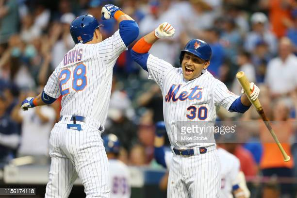 D Davis of the New York Mets celebrates with Michael Conforto after hitting a home run to left field in the second inning against the St Louis...