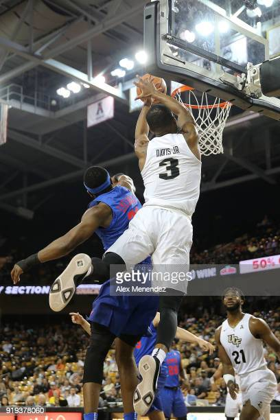J Davis of the UCF Knights attempts a shot in front of Ben Emelogu II of the Southern Methodist Mustangs during a NCAA basketball game at the CFE...