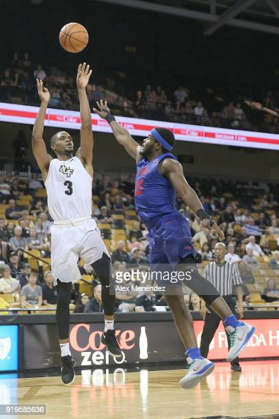 J Davis of the UCF Knights shoots over the hand of Ben Emelogu II of the Southern Methodist Mustangs during a NCAA basketball game at the CFE Arena...