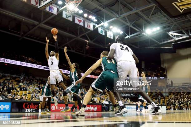 J Davis of the UCF Knights shoots the ball over James Currington of the Southeastern Louisiana Lions during a NCAA basketball game at the CFE Arena...