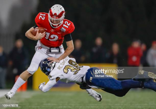 Davis Shanley of the Western Kentucky Hilltoppers is tackled on the run by Richard Dames of the Fiu Golden Panthers on October 27 2018 in Bowling...