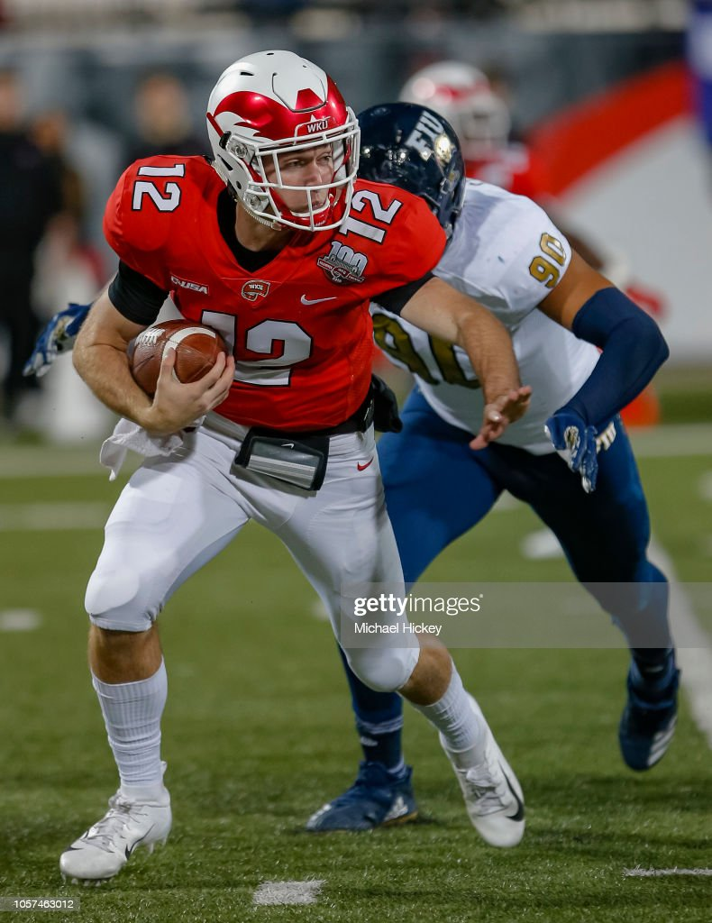 Davis Shanley of the Western Kentucky Hilltoppers runs the ...