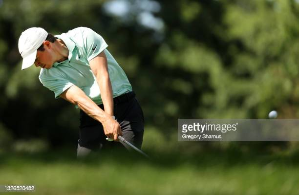 Davis Thompson plays his shot from the ninth tee during the first round of the Rocket Mortgage Classic on July 01, 2021 at the Detroit Golf Club in...