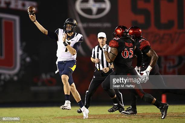Davis Webb of the California Golden Bears eludes Sergio Phillips of the San Diego State Aztecs during the first quarter of a game at Qualcomm Stadium...