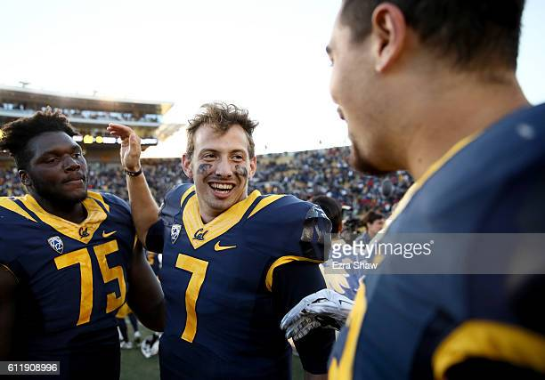 Davis Webb of the California Golden Bears is congratulated by Aaron Cochran and Jeremiah Stuckey after they beat the Utah Utes at California Memorial...