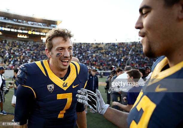 Davis Webb of the California Golden Bears is congratulated by Jeremiah Stuckey after they beat the Utah Utes at California Memorial Stadium on...