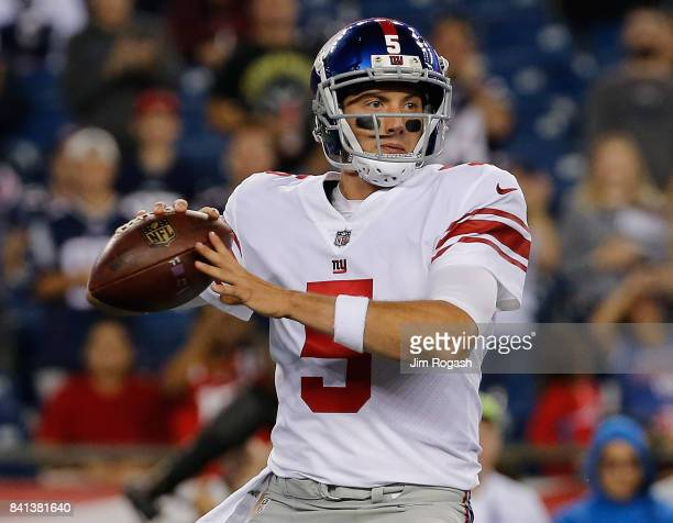 Davis Webb of the New York Giants prepares to throw in the second half during a preseason game with the New England Patriots in the first half at...
