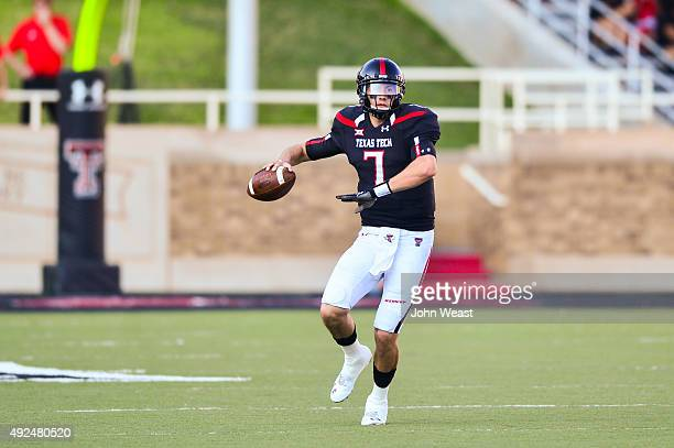 Davis Webb of the Texas Tech Red Raiders tools out to pass during the game against the Iowa State Cyclones on October 10 2015 at Jones ATT Stadium in...