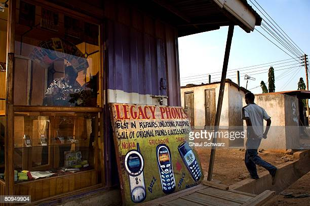 Davis works in his shop where he fixes cellular phones near the busy street market of La Paz November 18 2007 in Ghana Nokia has invested great...
