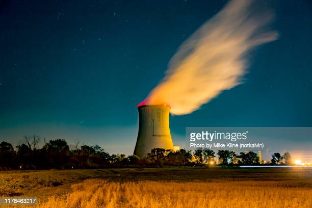 davis-besse nuclear power station under a star-filled sky - cooling tower stock pictures, royalty-free photos & images