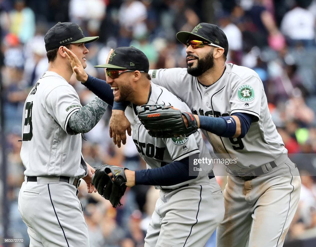 J.D. Davis #28,George Springer #4 and Marwin Gonzalez #9 of the Houston Astros celebrate the win over the New York Yankees at Yankee Stadium on May 28, 2018 in the Bronx borough of New York City.MLB players across the league are wearing special uniforms to commemorate Memorial Day.The Houston Astros defeated the New York Yankees 5-1.