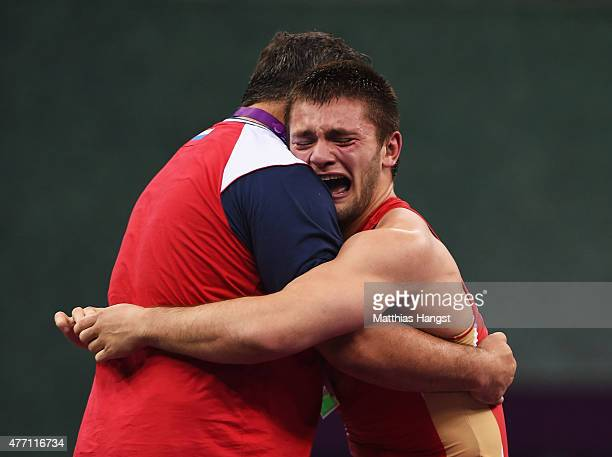 Davit Chakvetadze of Russia celebrates victory over Zhan Beleniuk of Ukraine in the Men's Wrestling 85kg Greco Roman final during day two of the Baku...