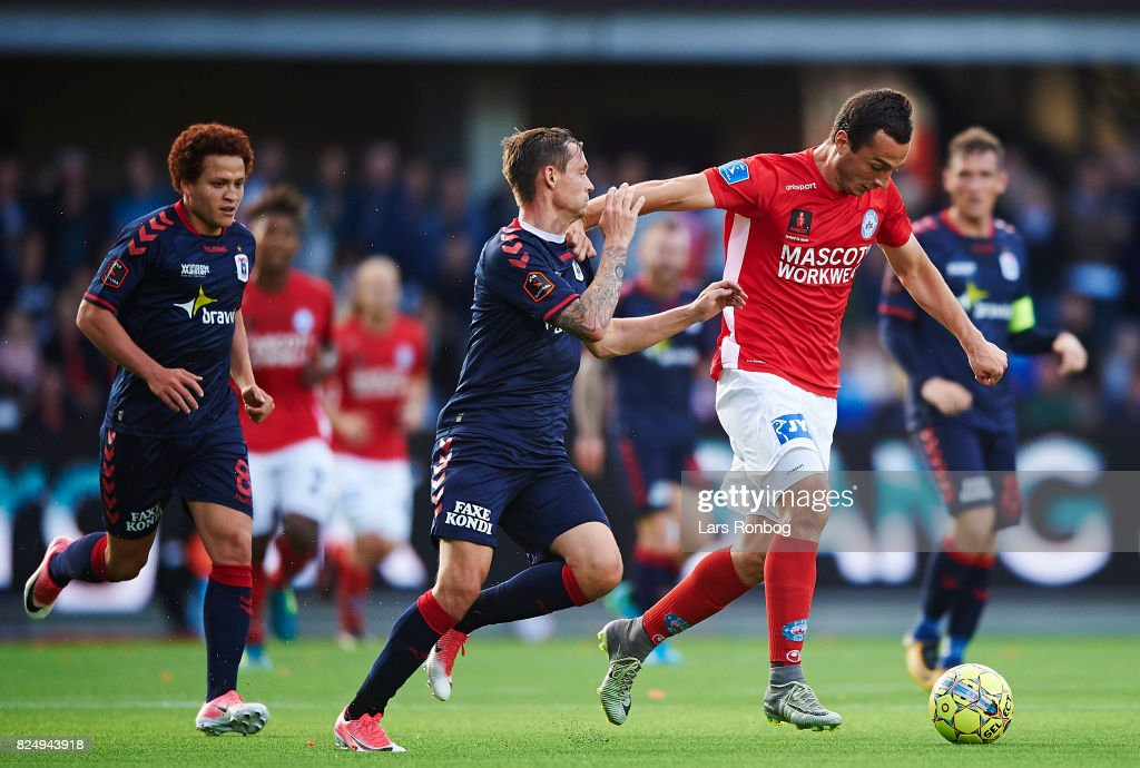 Davit Skhirtladze of Silkeborg IF and Jakob Ankersen of AGF Aarhus compete for the ball during the Danish Alka Superliga match between Silkeborg IF and AGF Aarhus at Jysk Park on July 31, 2017 in Silkeborg, Denmark.