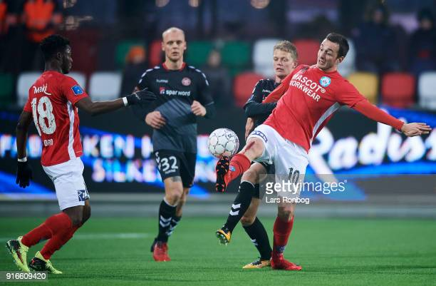 Davit Skhirtladze of Silkeborg IF and Kasper Kusk of AaB Aalborg compete for the ball during the Danish Alka Superliga match between Silkeborg IF and...