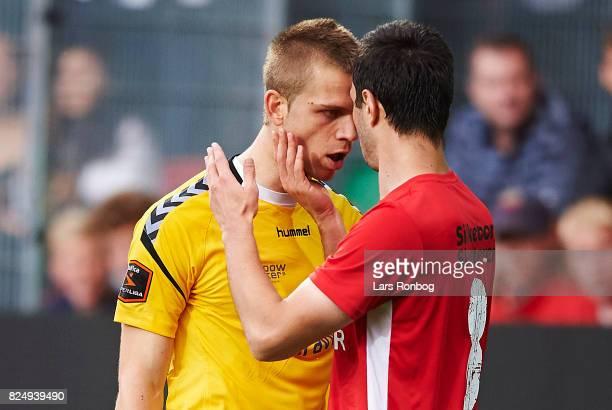 Davit Skhirtladze of Silkeborg IF in clinch with Goalkeeper Aleksandar Jovanovic of AGF Aarhus during the Danish Alka Superliga match between...