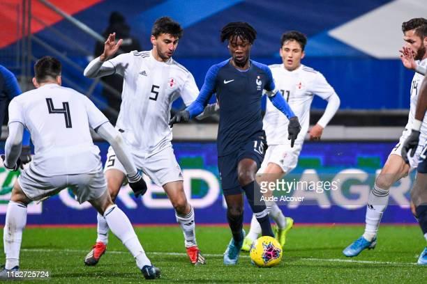 Daviti KOBOURI of Georgia and Eduardo CAMAVINGA of France during the UEFA European Championship Group B match between France U21 and Georgia U21 on...