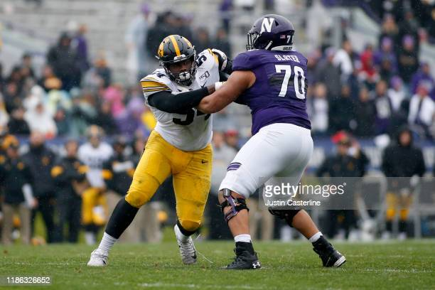 Daviyon Nixon of the Iowa Hawkeyes is blocked by Rashawn Slater of the Northwestern Wildcats at Ryan Field on October 26, 2019 in Evanston, Illinois.