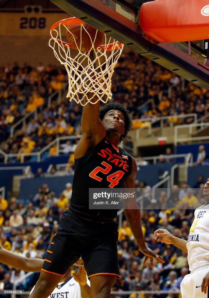 Davon Dillard #24 of the Oklahoma State Cowboys goes up for the jam against the West Virginia Mountaineers at the WVU Coliseum on February 4, 2017 in Morgantown, West Virginia.