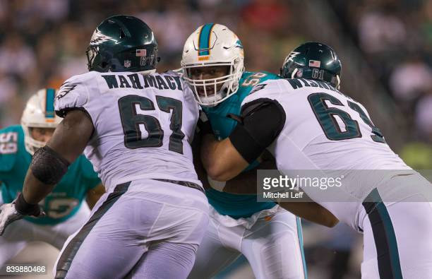 Davon Godchaux of the Miami Dolphins plays against Chance Warmack and Stefen Wisniewski of the Philadelphia Eagles in the preseason game at Lincoln...