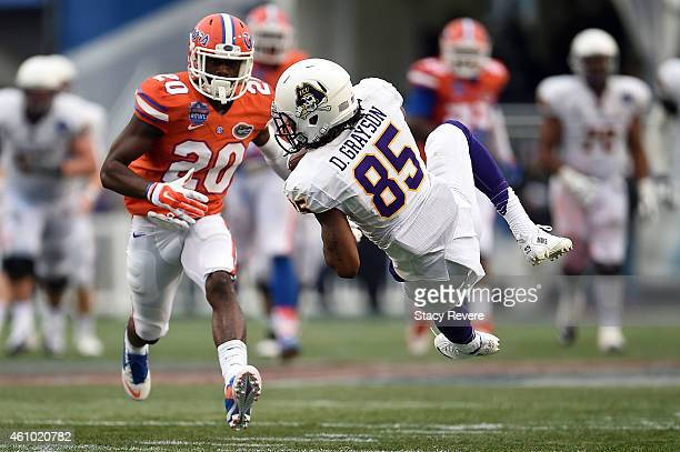 Davon Grayson of the East Carolina Pirates catches a pass in front of Marcus Maye of the Florida Gators during the Birmingham Bowl at Legion Field on...