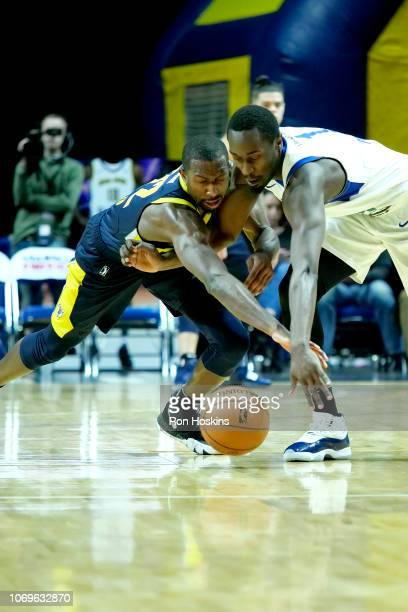 Davon Green of the Fort Wayne Mad Ants battles Theo Pinson of the Long Island Nets on December 7 2018 at Allen County War Memorial Coliseum in Fort...