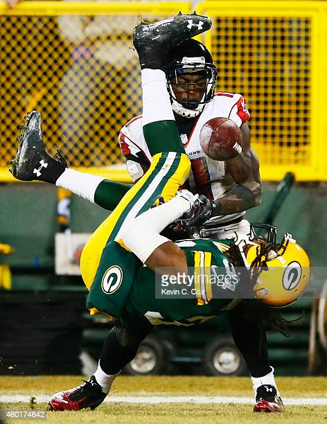Davon House of the Green Bay Packers breaks up a pass intended for Julio Jones of the Atlanta Falcons in the fourth quarter at Lambeau Field on...