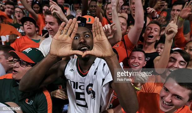 Davon Reed of the Miami Hurricanes celebrates with fans after the game against the North Carolina Tar Heels at the Watsco Center on January 28 2017...
