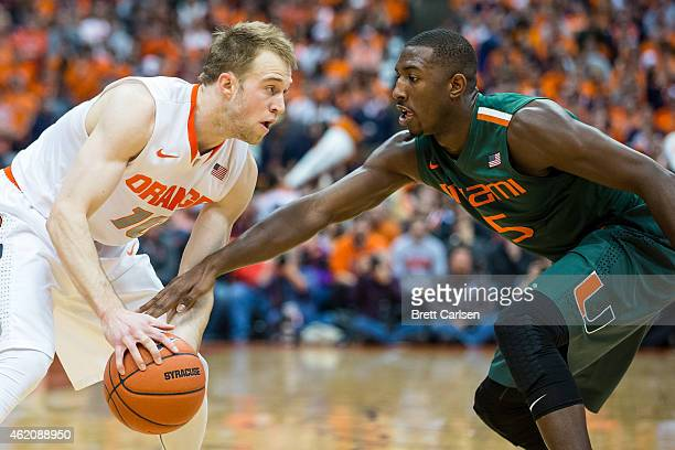 Davon Reed of the Miami Hurricanes defends as Trevor Cooney of the Syracuse Orange dribbles during the first half on January 24 2015 at The Carrier...