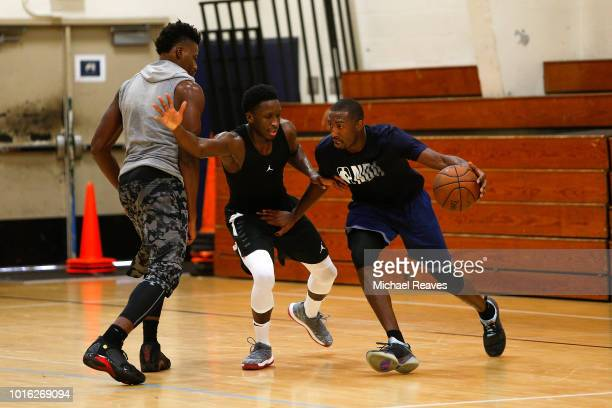 Davon Reed of the Phoenix Suns is defended by Victor Oladipo of the Indiana Pacers during NBA Offseason training with Remy Workouts on August 9 2018...