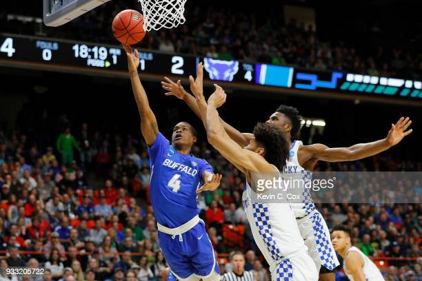 Davonta Jordan of the Buffalo Bulls drives to the basket against Nick Richards and Hamidou Diallo of the Kentucky Wildcats during the first half in...