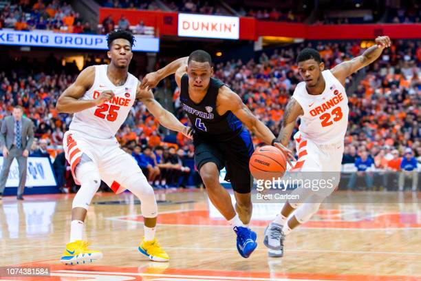 Davonta Jordan of the Buffalo Bulls drives to the basket during the first half between Tyus Battle and Frank Howard of the Syracuse Orange at the...