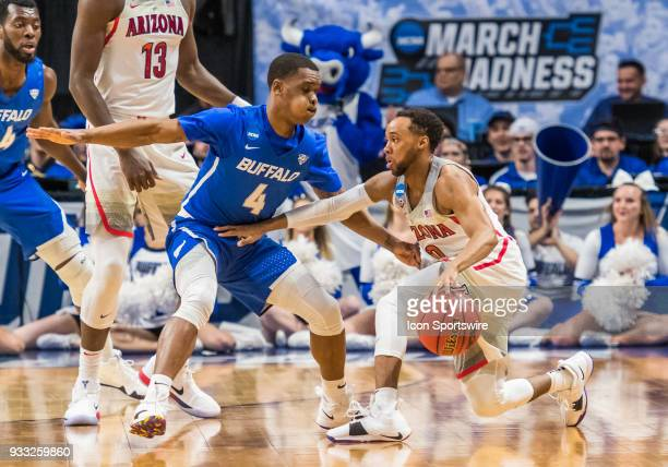 Davonta Jordan of the Buffalo Bulls holds up G Parker JacksonCartwright of the Arizona Wildcats during the NCAA Division I Men's Championship First...
