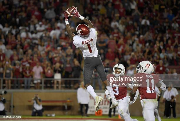 Davontavean Martin of the Washington State Cougars catches an eight yard touchdown pass against the Stanford Cardinal during the fourth quarter of...