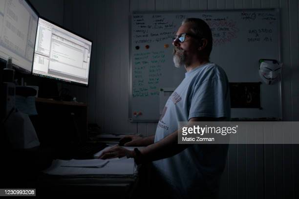 Davor, a 53 year old programmer writes code and works on computer while walking on a treadmill on February 5, 2021 in Putal, Slovenia. He had his...