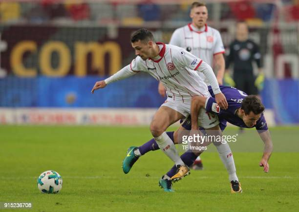 Davor Lovren of Duesseldorf and Clemens Fandrich of Aue battle for the ball during the Second Bundesliga match between Fortuna Duesseldorf and FC...