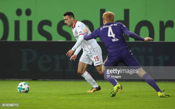 Davor Lovren of Duesseldorf and Fabian Kalig of Aue battle for the ball during the Second Bundesliga match between Fortuna Duesseldorf and FC...