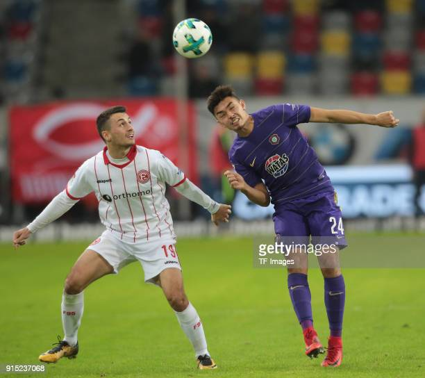 Davor Lovren of Duesseldorf and JohnPatrick Strauss of Aue battle for the ball during the Second Bundesliga match between Fortuna Duesseldorf and FC...