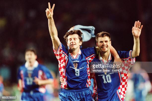 Davor Suker and Zvonimir Boban of Croatia celebrate their victory over Holland , and third place finish