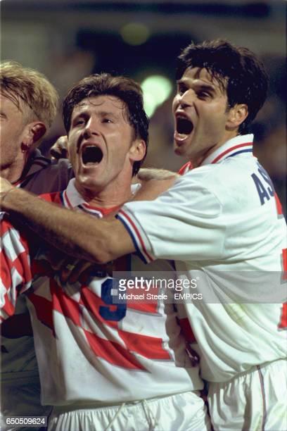 Davor Suker of Croatia celebrates scoring the third goal with teammate Aljosa Asanovic