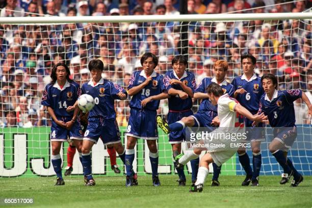 Davor Suker of Croatia curls a free kick around the Japan wall