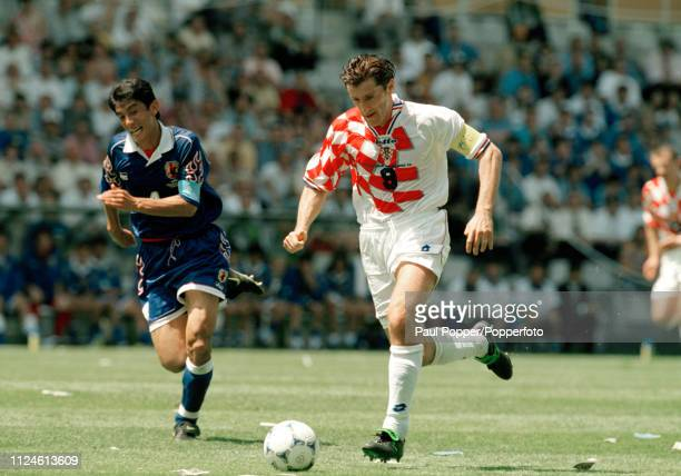 Davor Suker of Croatia is chased down by Masami Ihara of Japan during the 1998 FIFA World Cup Group H match at the Stade de la Beaujoire on June 20...