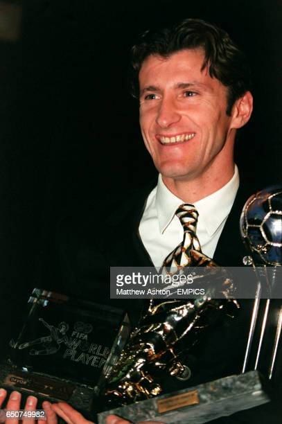 Davor Suker of Real Madrid and Croatia with his gold adidas boot award FIFA World Player of the Year Award and adidas silver ball for France 98 award