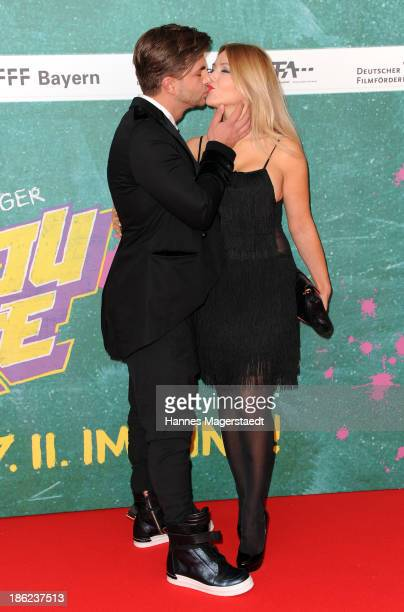 Davorka Tovilo and her boyfriend Sasa Pasajlic attends the premiere of the film 'Fack Ju Goehte' on October 29 2013 in Munich Germany