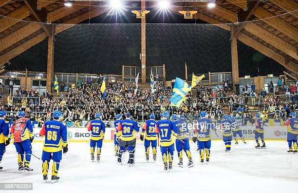Davos celebrate their 31 victory during the Champions Hockey League match between HC Davos and Djurgarden Stockholm at Vaillant Arena on September 2...